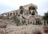 Syrian government forces sift through the rubble on May 8