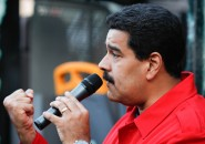 Venezuelan President Nicolas Maduro speaks to people gathered outside