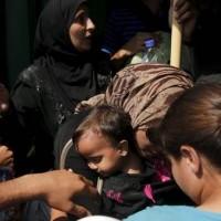 Refugiados-abordan-Eleftherios-Venizelos-Pireo_CLAIMA20150908_0032_28