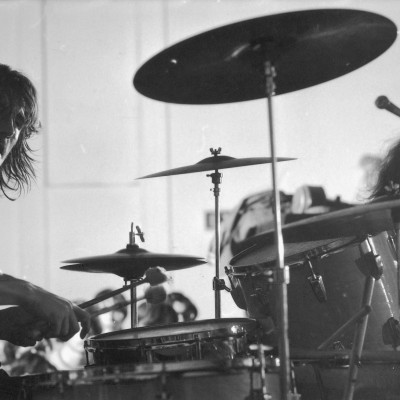 British drummer John Bonham (1948 - 1980) of the rock and roll group Led Zeppelin plays during a rehearsal for their second American tour, May 1969. Guitarist Jimmy Page is visble (but partly obscured) at right. (Photo by Charles Bonnay/Time & Life Pictures/Getty Images)