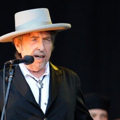 US legend Bob Dylan performs on stage during the 21st edition of the Vieilles Charrues music festival on July 22, 2012 in Carhaix-Plouguer, western France.  AFP PHOTO / FRED TANNEAU