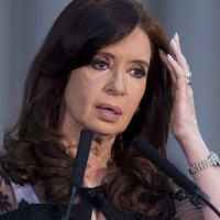 FILE - In this Dec. 10, 2013 file photo, Argentina's President Cristina Fernandez pauses as she speaks at an event marking the 30 year anniversary of the return of democracy in Buenos Aires, Argentina. A puzzling silence has descended around Fernandez, feeding speculation in Argentina about her health and questions about who's running the country. (AP Photo/Victor R. Caivano, File)