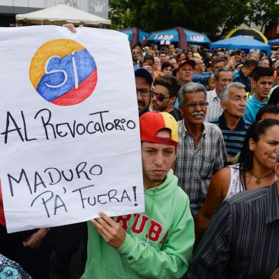 Anti-government demonstrators gather to sign the form to activate the referendum on cutting President Nicolas Maduro's term short, in Caracas on April 27, 2016. Opponents of Venezuelan President Nicolas Maduro hope to hold a referendum on removing him from office as early as November, a leading opposition figure said Wednesday. The center-right opposition has started gathering signatures to launch the first step towards a referendum to get rid of the socialist leader, whom they blame for an economic crisis and rising unrest.  / AFP / FEDERICO PARRA        (Photo credit should read FEDERICO PARRA/AFP/Getty Images)