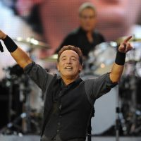 "Singer Bruce Springsteen and the E-street band perform during their concert at Molinon Stadium in Gijon, northern Spain in this June 26, 2013 file photo. Bruce Springsteen will publish an autobiography in September that he promises will show readers how his personal struggles inspired his music, including his classic 1975 hit ""Born to Run."" REUTERS/Eloy Alonso/Files"