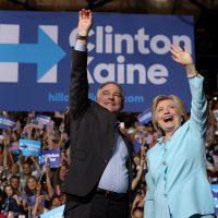 MIAMI, FL - JULY 23: Democratic presidential candidate former Secretary of State Hillary Clinton and Democratic vice presidential candidate U.S. Sen. Tim Kaine (D-VA) greet supporters during a campaign rally at Florida International University Panther Arena on July 23, 2016 in Miami, Florida. Hillary Clinton and Tim Kaine made their first public appearance together a day after the Clinton campaign announced Senator Kaine as the Democratic vice presidential candidate.   Justin Sullivan/Getty Images/AFP == FOR NEWSPAPERS, INTERNET, TELCOS & TELEVISION USE ONLY ==