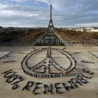 Hundreds of environmentalists arrange their bodies to form a message of hope and peace in front of the Eiffel Tower in Paris, France, December 6, 2015, as the World Climate Change Conference 2015 (COP21) continues at Le Bourget near the French capital. REUTERS/Benoit Tessier      TPX IMAGES OF THE DAY      - RTX1XF6V