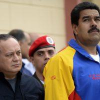 Venezuela's National Assemby President Diosdado Cabello (L) and Venezuelan president Nicolas Maduro (R), attend a ceremony  three months after Hugo Chavez's death, at the Cuartel de la Montana in Caracas, on June 05, 2013.   AFP  PHOTO/JUAN BARRETO        (Photo credit should read JUAN BARRETO/AFP/Getty Images)