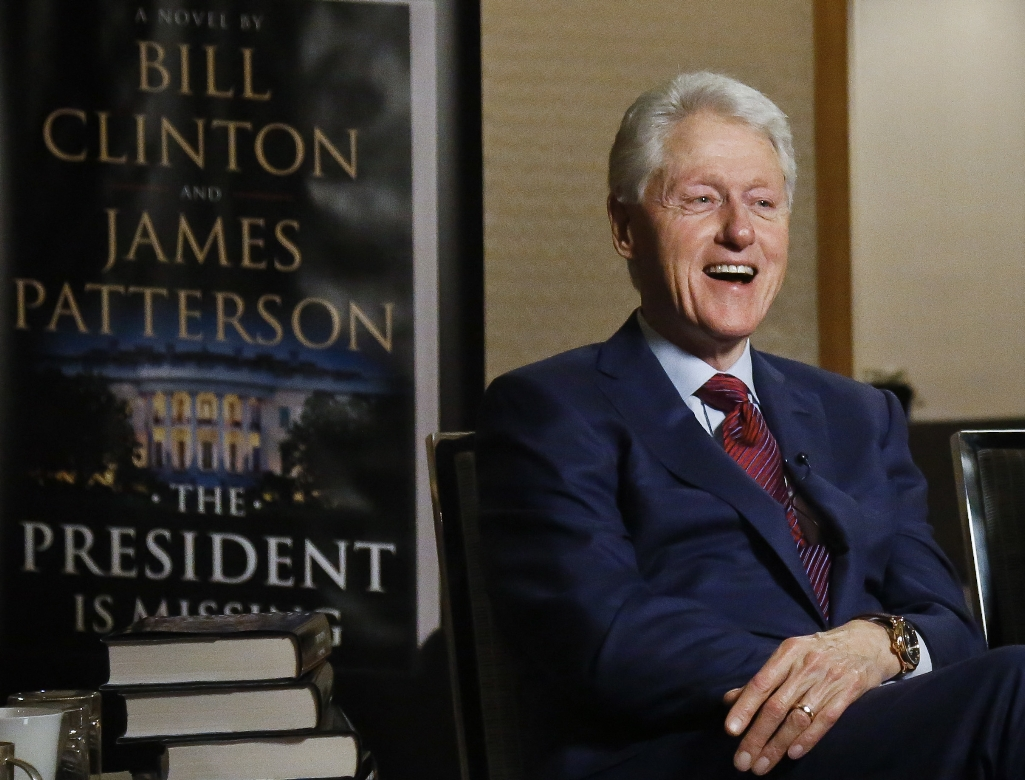 """In this Monday, May 21, 2018, photo, former President Bill Clinton speaks during an interview about a novel he wrote with James Patterson, """"The President is Missing,"""" in New York. (AP Photo/Bebeto Matthews)"""