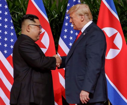 Mandatory Credit: Photo by Evan Vucci/AP/Shutterstock (9710094b) Donald Trump, Kim Jong Un. U.S. President Donald Trump shakes hands with North Korea leader Kim Jong Un at the Capella resort on Sentosa Island in Singapore Trump Kim Summit, Singapore, Singapore - 12 Jun 2018 Funk