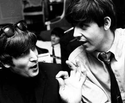 PAUL MCCARTNEY AND JOHN LENNON - PARIS 1964. (Express Newspapers Via AP Images)