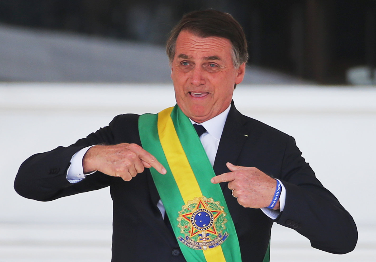 Brazil's new President Jair Bolsonaro gestures after receiving the presidential sash from outgoing President Michel Temer at the Planalto Palace, in Brasilia, Brazil January 1, 2019. REUTERS/Sergio Moraes